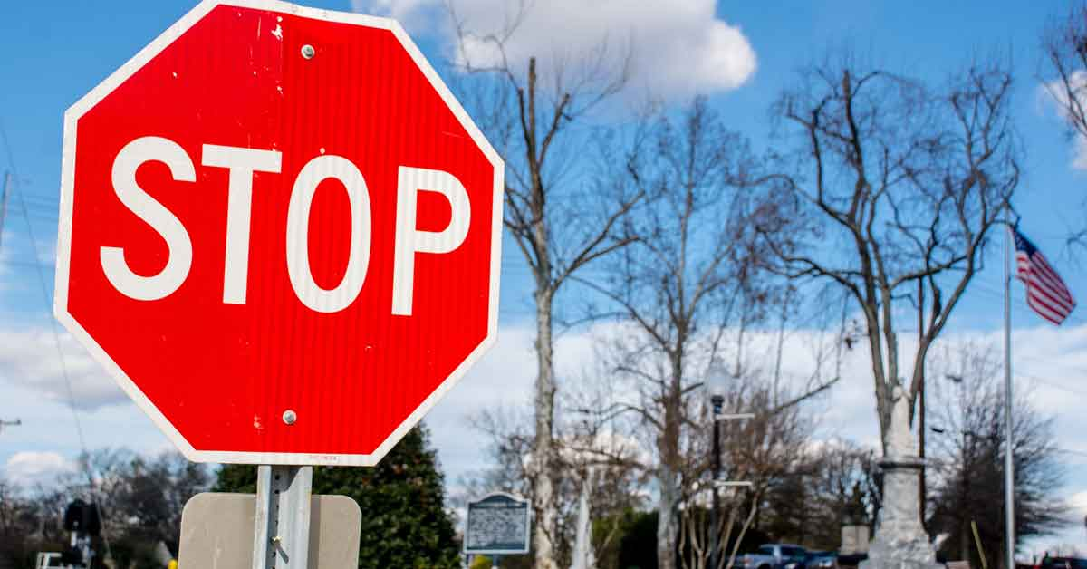A stop sign on a local road.